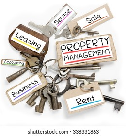 Photo of key bunch and paper tags with PROPERTY MANAGEMENT conceptual words