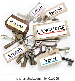 Photo of key bunch and paper tags with LANGUAGE conceptual words