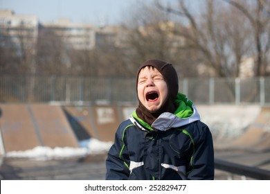 photo of a kid crying very loud in a temper tantrum