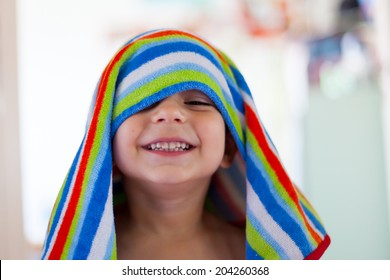 photo of kid out of the bath with wet hair and towel