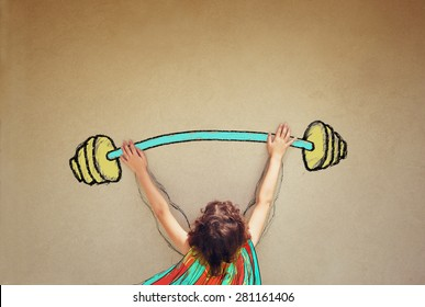 photo of kid's back view lifting up barbell weights against textured background