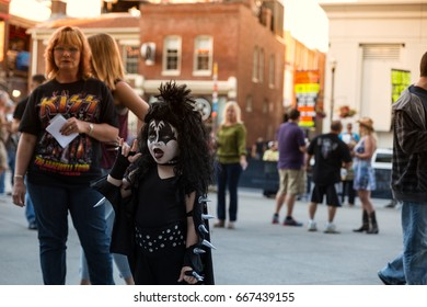 Photo of KISS fan / child with mom in makeup. July 16, 2014 KISS concert held in Nashville, TN. Photos taken outside Bridgestone Arena on Broadway in Nashville.