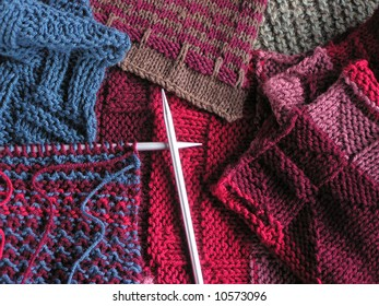 Photo of knitted fabrics and needles with project on them