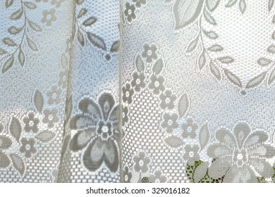 Photo of a lace curtains in the window