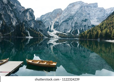 photo of Lake Braies (Lago di Braies) in Dolomites Mountains, Italy. Hiking travel and adventure.