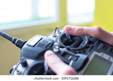 Photo of large radio remote control in the boy's hand