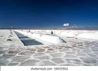 Photo of large salt mines Purmamarca Salinas grandes and workers in Salta, city in Argentina.