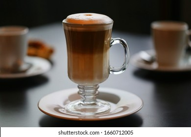 Photo of a large tasty cup of coffee with milk in a restaurant. Advertising coffee drink.