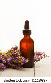 photo of lavender essential oil over wooden table
