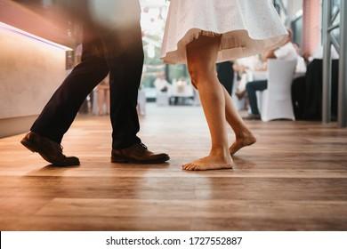 photo of legs of a couple dancing indoor