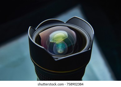 Photo lens with a blend close-up on a dark background