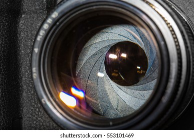 Photo lenses with iris and reflections close up
