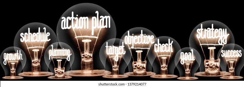 Photo of light bulb group with shining fibers in a shape of Action Plan, Strategy, Schedule and Objective concept related words isolated on black background