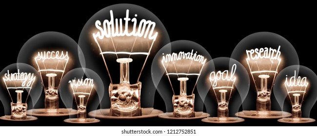 Photo of light bulbs group with shining fibers in a shape of SOLUTION concept related words isolated on black background