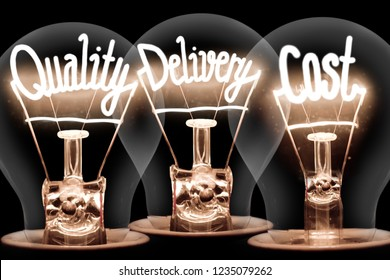 Photo of light bulbs group with shining fibers in a shape of QUALITY, DELIVERY and SERVICE concept words isolated on black background
