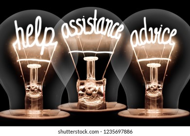 Photo of light bulbs group with shining fibers in a shape of HELP, ASSISTANCE and ADVICE concept words isolated on black background