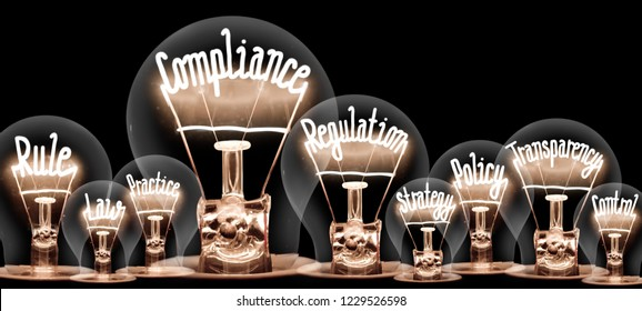 Photo of light bulbs with shining fibers in a shape of COMPLIANCE concept related words isolated on black background