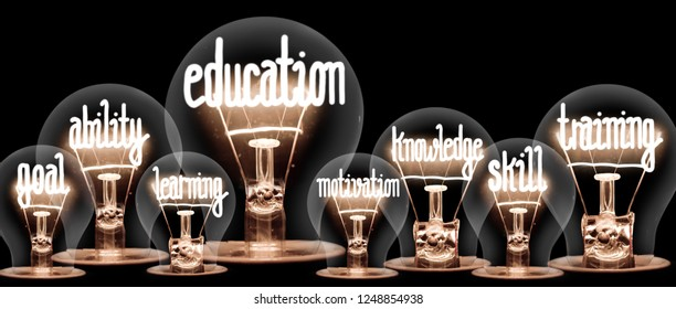 Photo of light bulbs with shining fibers in a shape of EDUCATION concept related words isolated on black background