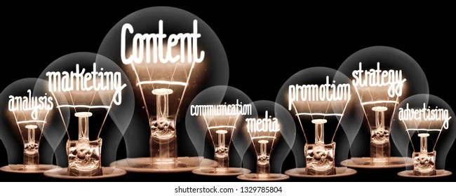 Photo of light bulbs with shining fibers in a shape of CONTENT, MARKETING and STRATEGY concept related words isolated on black background