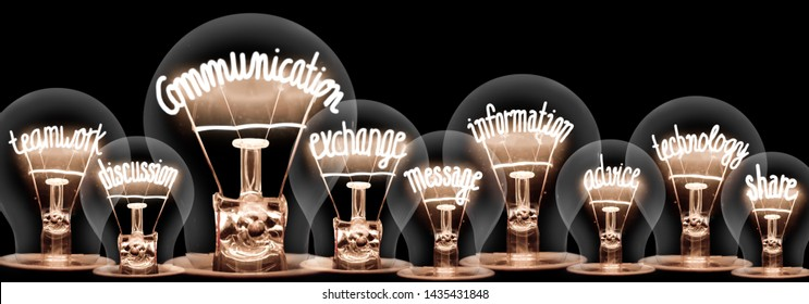 Photo of light bulbs with shining fibers in a shape of Communication, Teamwork, Exchange and Technology concept related words isolated on black background