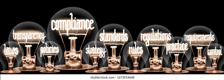 Photo of light bulbs with shining fibers in a shape of Compliance, Standards, Regulations and Transparency concept related words isolated on black background