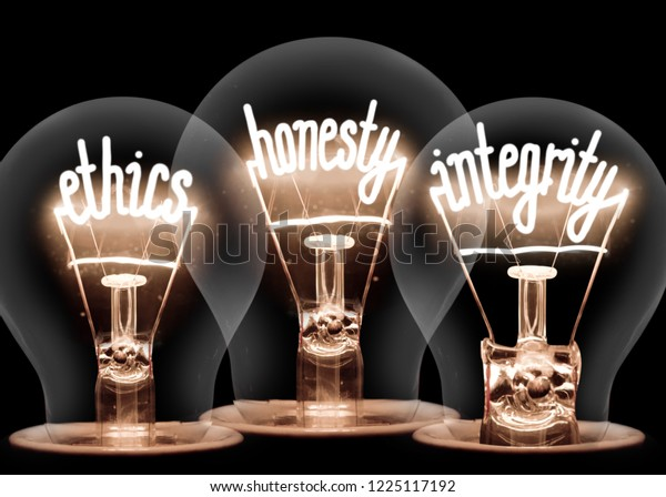 Photo of light bulbs with shining fibres in ETHICS, HONESTY and INTEGRITY shape isolated on black background