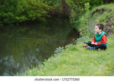 photo of little boy fishing