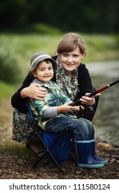 photo of little boy and mother fishing
