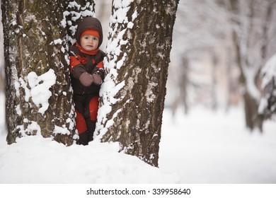 photo of little boy in winter park