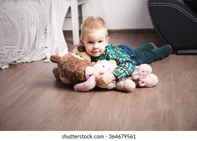 photo of little cute boy with many toys