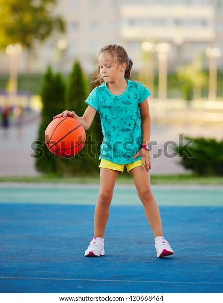 Photo Little Cute Girl Playing Basketball Stock Photo Edit Now