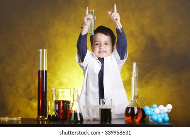 photo of little funny chemist at work