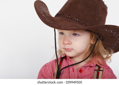 photo of little funny cowgirl on white background