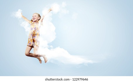 Photo of little girl jumping and raising hands against light background