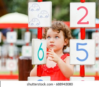 Photo of little girl playing on the playground