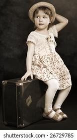 photo little girl of retro stiles on black background