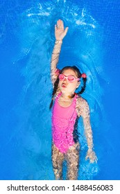 photo of little girl in swimming pool