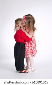 photo of lovely boy and girl on white