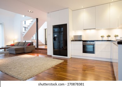 Photo of luxury kitchen with modern living room