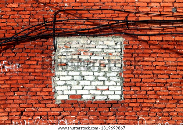 Photo macro background of a fragment of the brick walls