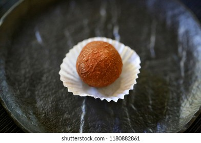 Photo of a macro chocolate candy on a dark background