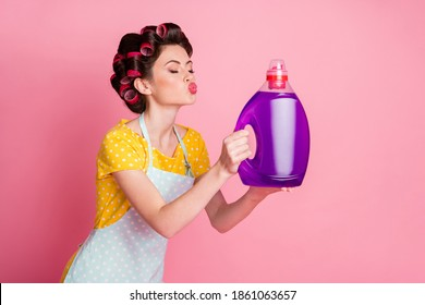 Photo of maid send air kiss washer powder liquid wear yellow dotted t-shirt isolated pastel color background