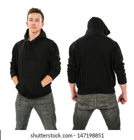 Photo of a male in his late teens posing with a blank black hoodie.  Front and back views ready for your artwork or designs.