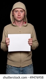 photo male in a hoodie holding blank advert space