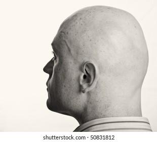 photo male portrait b&w close up on white backdrop