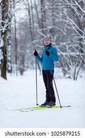 Photo of male skier in blue jacket at winter forest