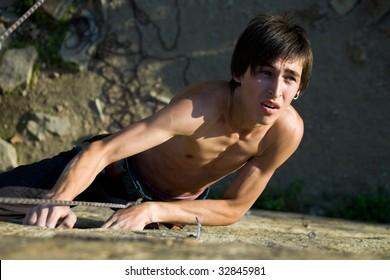 Photo of man climbing up the mountain