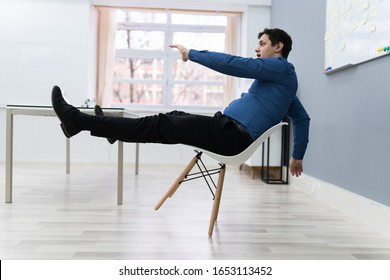 Photo Of Man Falling On Chair In Office