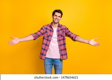 Photo of man opening his arms wide to hug his girlfriend he has not seen for ages while isolated with yellow background