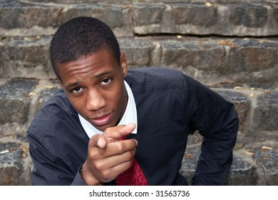 photo of a man pointing at you